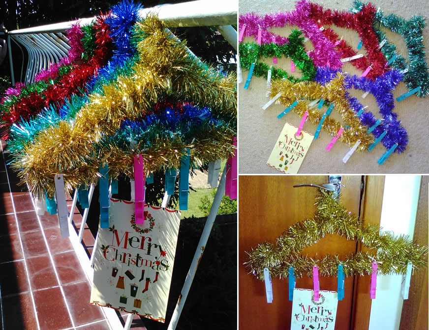 Wire coat hanger covered with tinsel, attach pegs with ribbon.