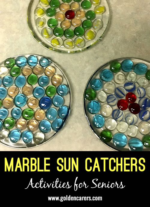 Beautiful sun catchers made with marbles! Mine has been hanging in the Georgia sun for over a year and the glue has not melted.